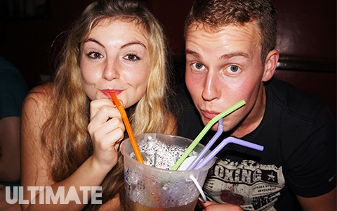 Drinking alcohol from buckets at the full moon party